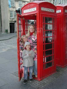 Mom and her 2 children in a Scottish phone booth.