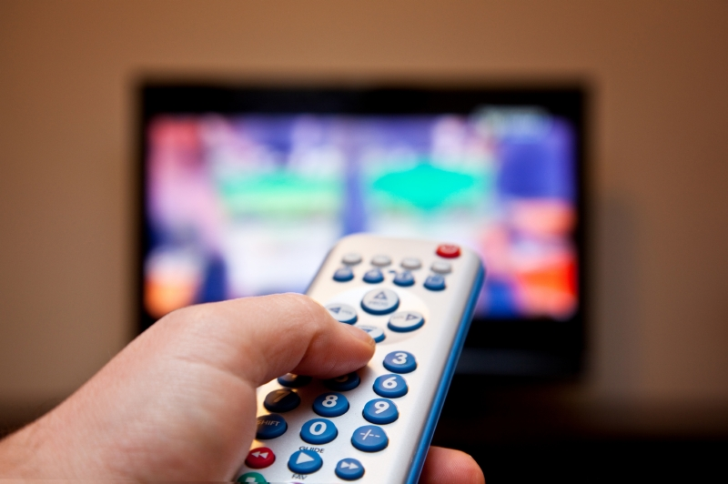 Showing a television and a viewer with a remote.