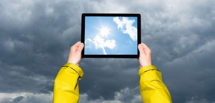 Child looking at a storm on a tablet