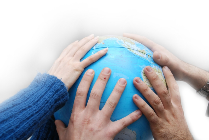 Hands on globe, like teamwork