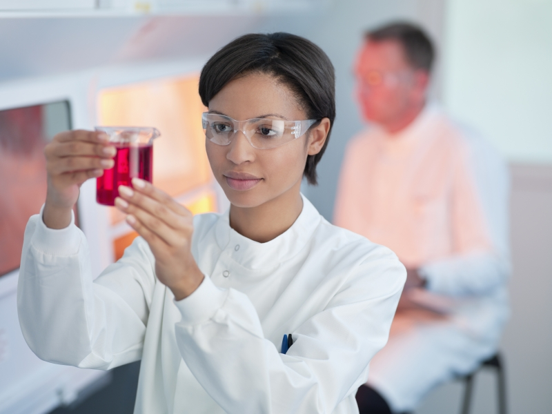 scientist in lab measuring liquid