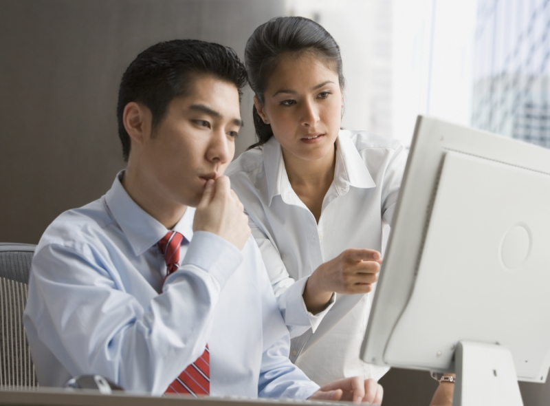 two people looking at data quality mistakes
