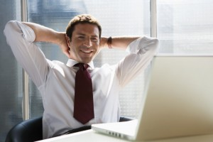 satisfied man at computer