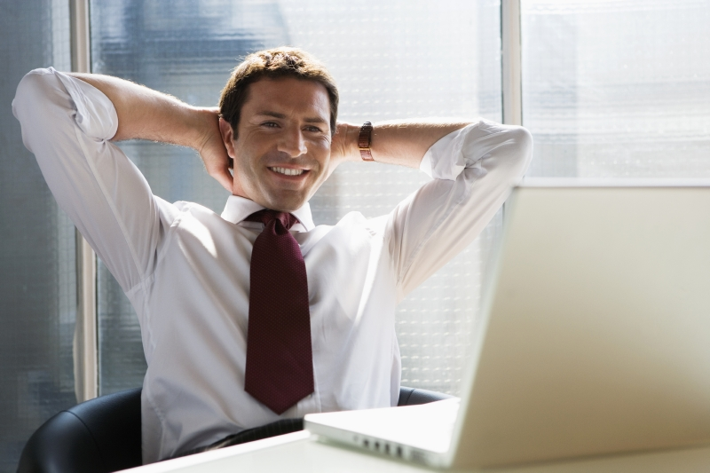 satisfied man at computer