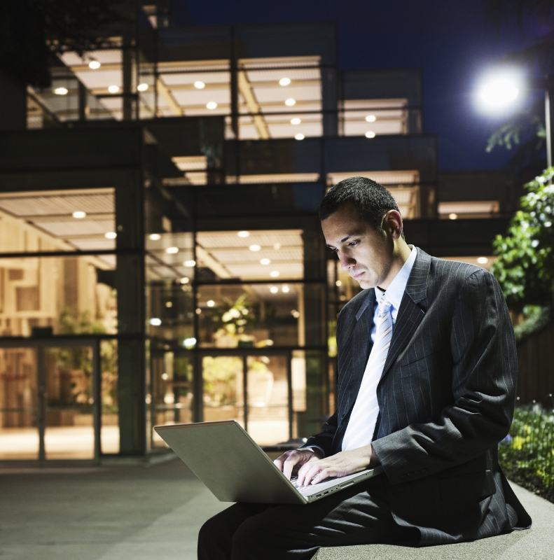 man working with data outside at night