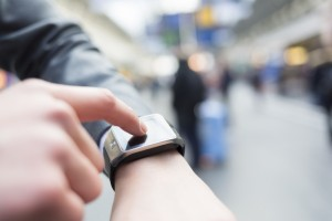 person checking a smart watch