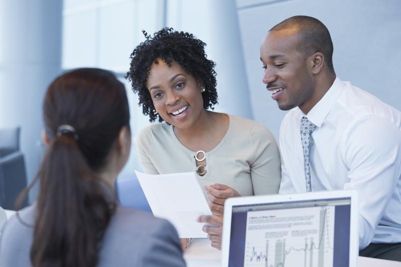 copule discussing credit application, represents MDM
