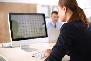 woman at computer doing data governance