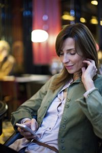 woman using social media on cell phone