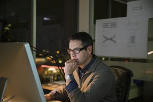 man at computer considering data ops