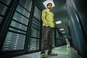 man in server room contemplating data lakes