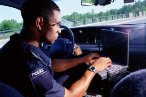 policeman records evidence similar to preparing a business glossary