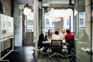 team meeting to discuss data quality SLAs