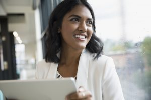 woman with tablet, managing data where it lives