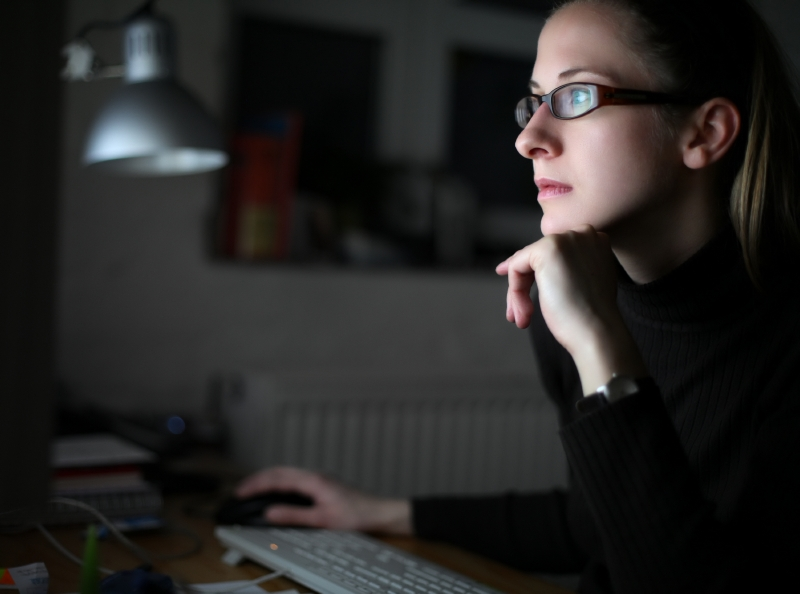woman working late to govern data acquisition