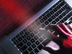hacker taking advantage of IoT