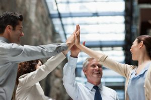 4 people celebrate how SAS makes Hadoop easy