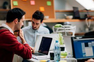 young IT men work on the evolution of Hadoop