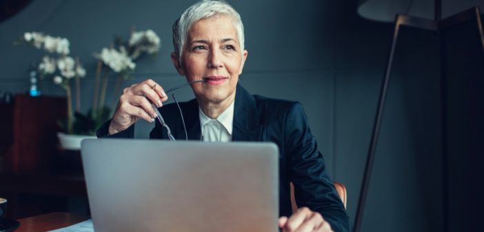 mature businesswoman considers two different types of MDM