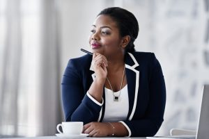 businesswoman considering data lakes and hadoop