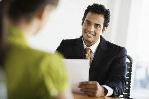 insurance agents talks with happy customer