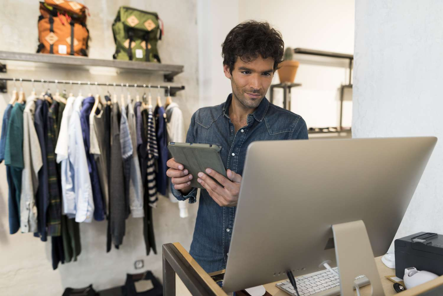 Male store owner tries to understand the data for omnichannel