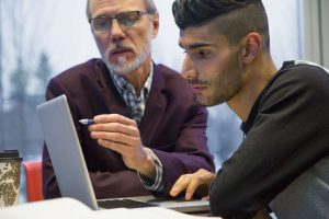 Instructor teaches student about data-driven design