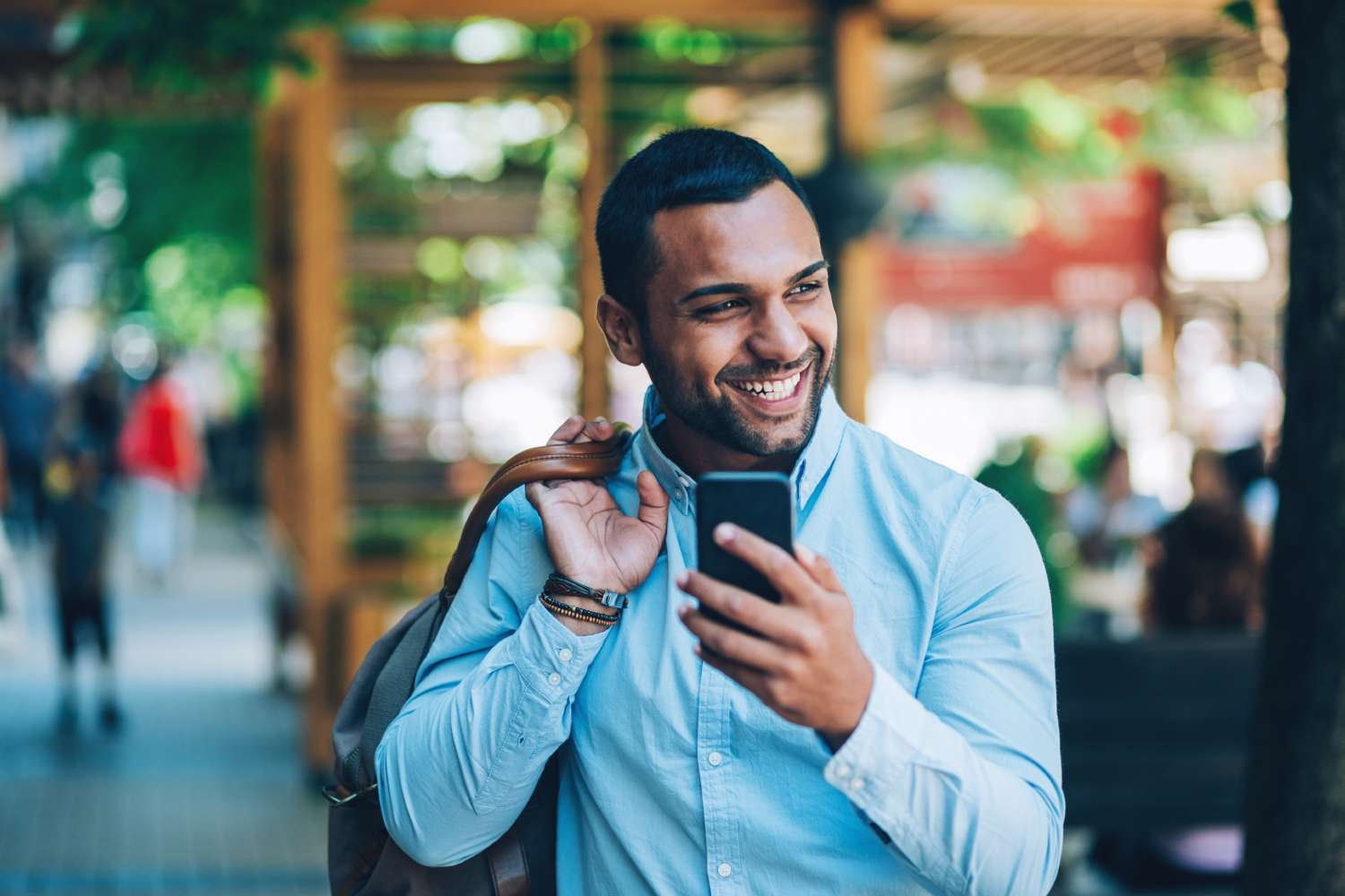 Man on smartphone considers data privacy concerns