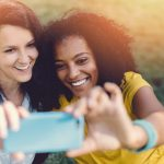 Young women taking a selfie, probably not considering if GDPR will shift perspectives on personal data
