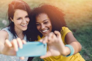 Young women taking a selfie, probably not considering if GDPR will shift focus on personal data