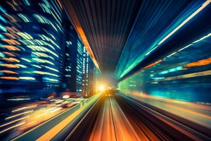 blurred city and car lights represent fast streaming data