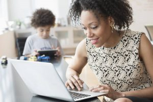 Businesswoman working from home with child on Data Privacy Day
