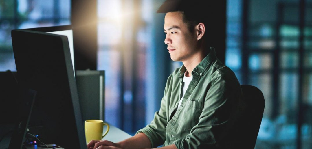 Young businessman working late to try to improve data accuracy