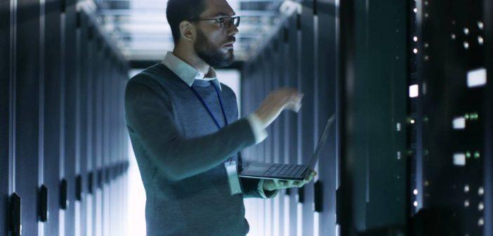 Man in server room, concept of data lake
