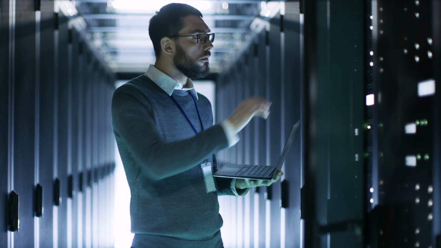 Man in server room, concept of data lake