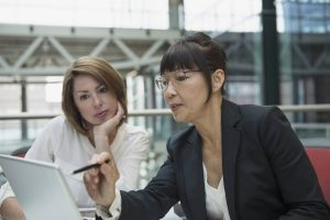 Business women discuss data tagging for their organization
