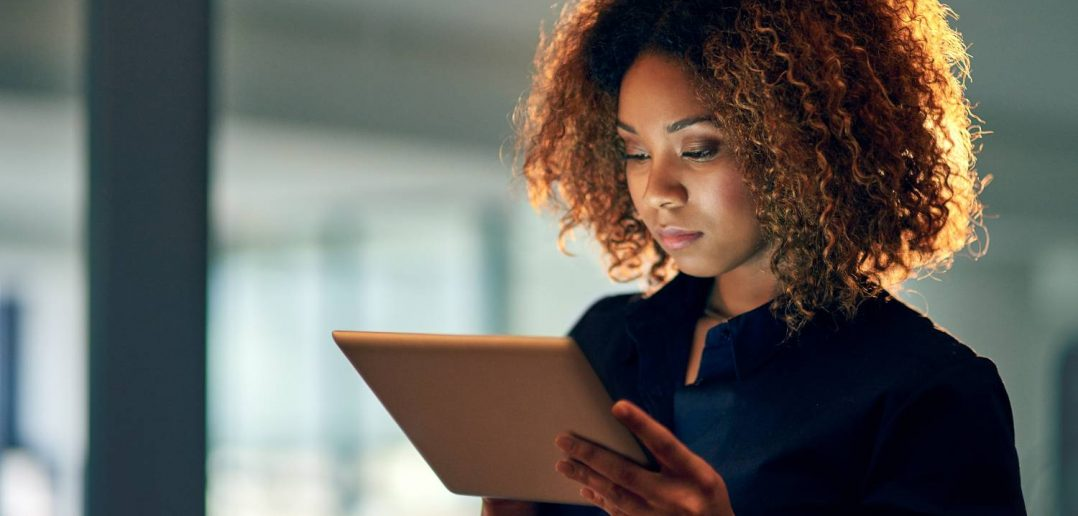 Business woman reads up on self-service data preparation