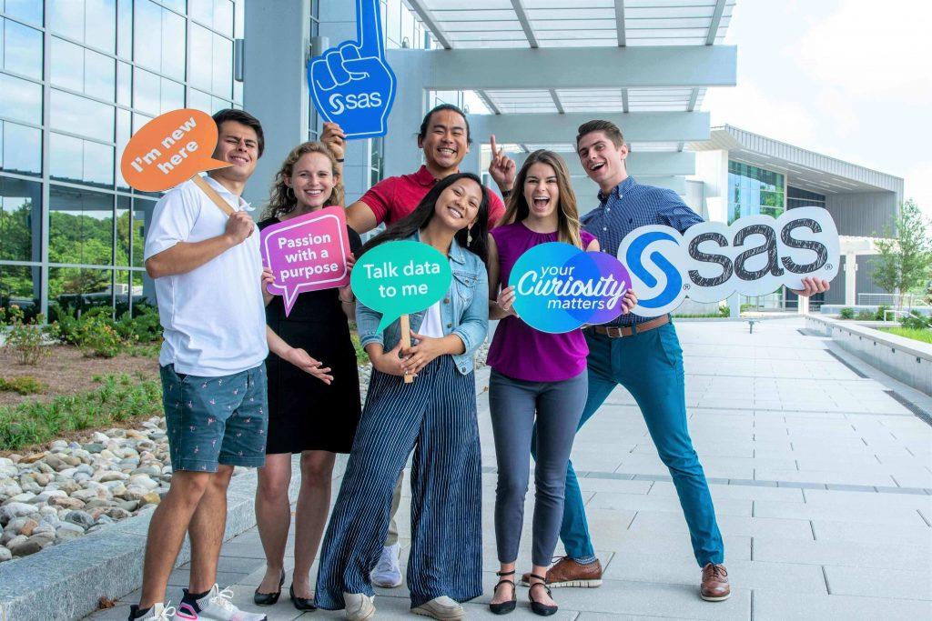 SAS interns pose with SAS signs