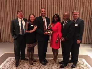 Tim accepts the Thurgood Marshall College Fund Presidential Leadership Award