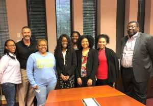 Tim Wilson and John Pierre, Chancellor of Southern University Law Center, stand with law students.