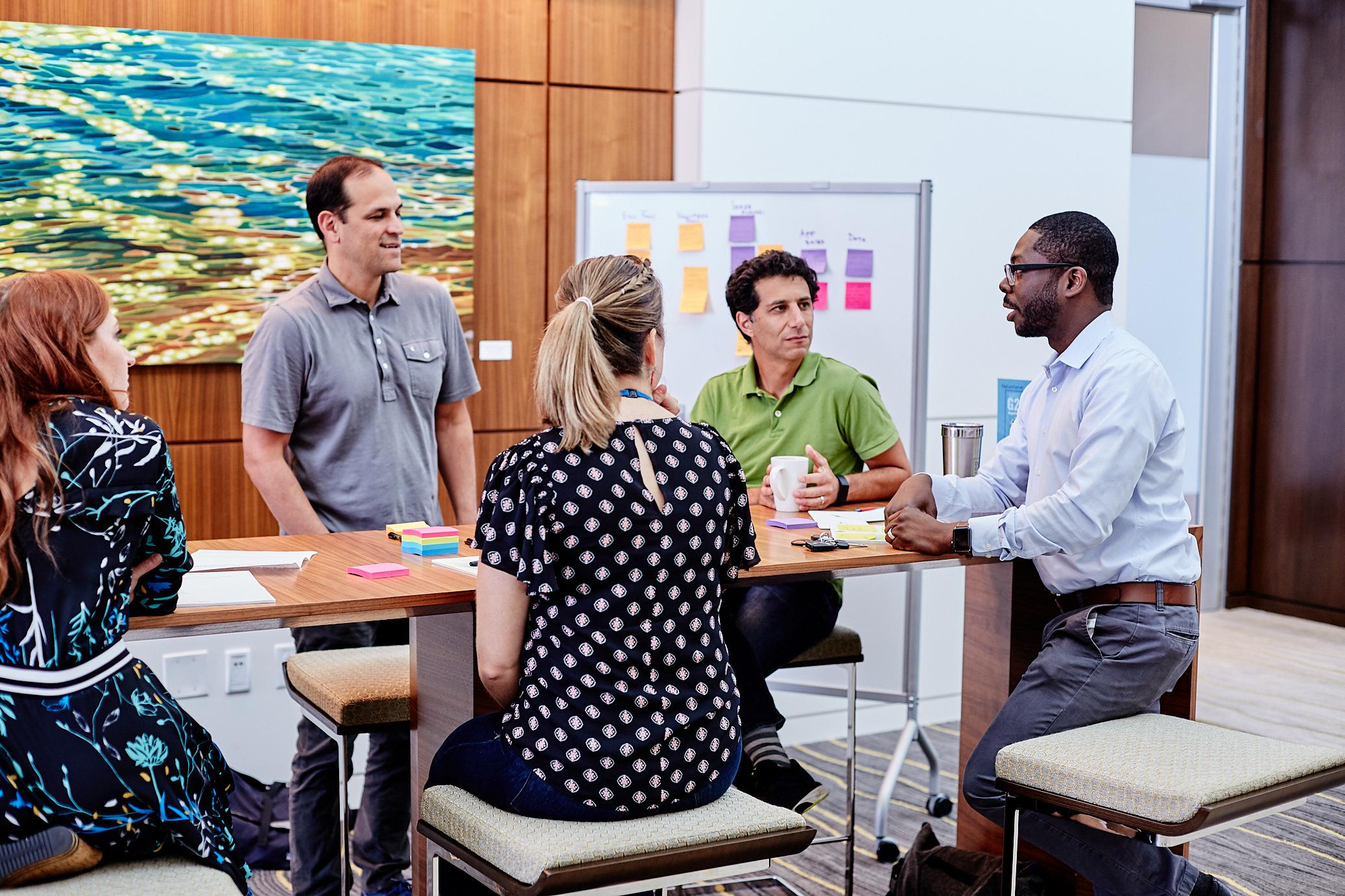 SAS employees converse at the Social Innovation Showcase