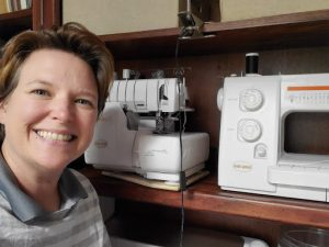 Catherine poses with her sewing machines