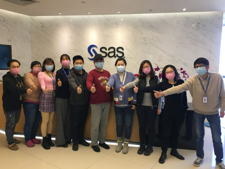 """SAS China employees give """"thumbs up"""" to the camera on their first day back at the office."""