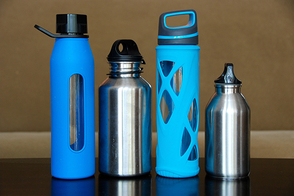 four water bottles alternating glass and stainless steel