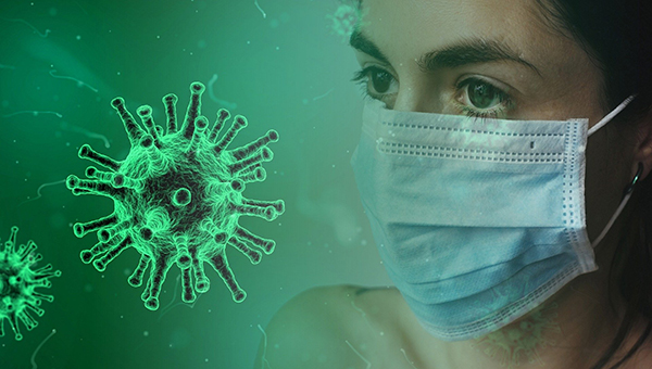 woman's face with mask and green coronavirus image