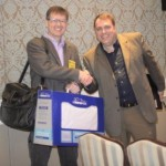 Receiving pillow from Eric Wilson of Tempur Sealy