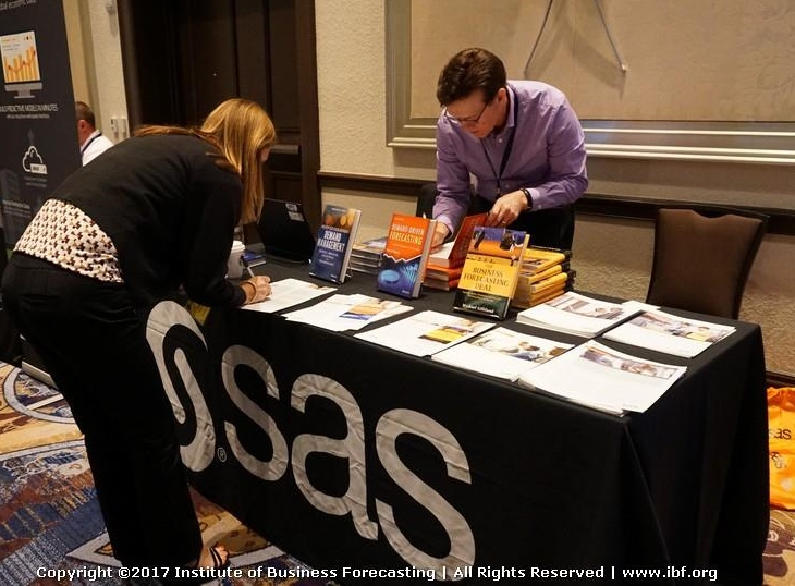 signing books at the SAS table