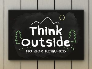 Think outside no box required on black board. Green and travel concept.
