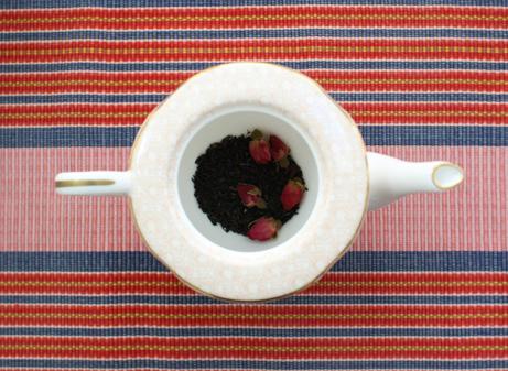 tea pot with tea leaves in it