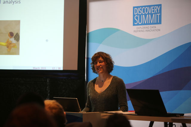 Speaker on stage at Discovery Summit Brussels